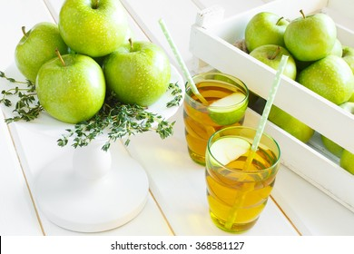 Top View of apple juice. Apples in a wooden box