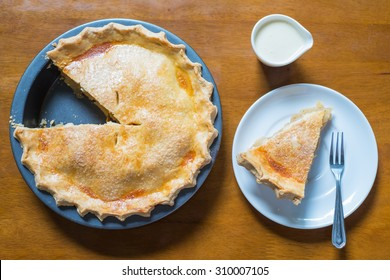 Top view, Apple pie and a piece of apple pie on a wooden table.