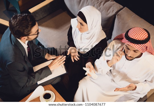 Top view. Arab couple at reception of psychologist. Family psychotherapy concept.