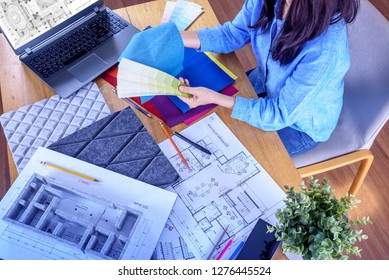 Top view of Architect -Interior designer (Artist creative) working with drawing sketch, architecture model, material sample, laptop in office / Renovation, decoration & Real estate business conceptual