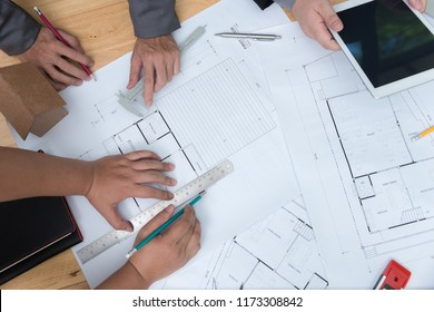 Top view of  Architects engineer discussing on desk with blueprint. Team group on construciton site check documents and business workflow.Construction concept. Engineering tools.Vintage effect.