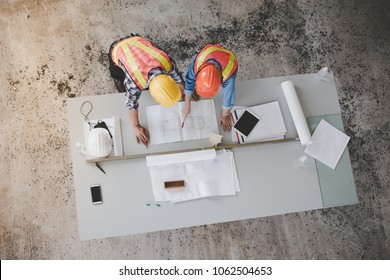 Top view of architects and engineers to help create a blueprint to build a modern building equipped with the skills to fix errors and make suggestions during construction.
