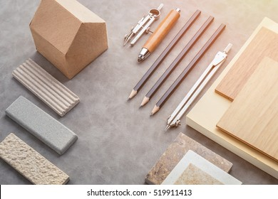 Top view of architects table with stuff of modern house with material sample on creative desk with free copyspace