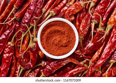 top view of arranged grinded and wholesome chili peppers