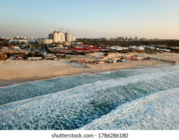 Top view of Ashkelon beach and waves of surf on the Mediterranean Sea