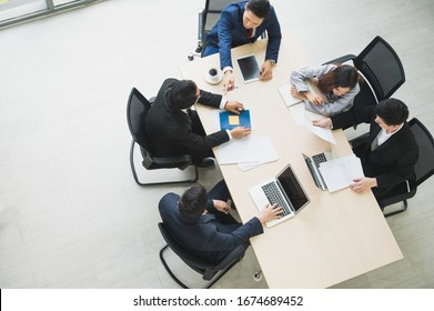 Top view of  asian business people team analyzing statistics financial. High angle view of a team of businesspeople Meeting Conference Discussion Corporate Concept in office.