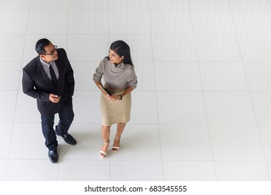 Top view, Asian business people, man and woman, talking about ideas, copy space, selective focus