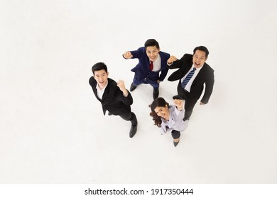 Top view of Asian business team celebrating a triumph with arms up isolated on white background, Successful entrepreneurs and business people concept