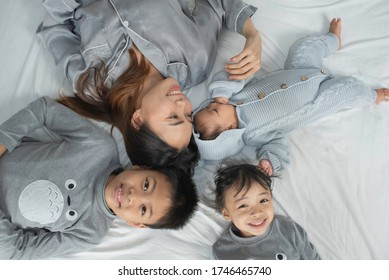 Top view Asian family ,Mother and child in bed.