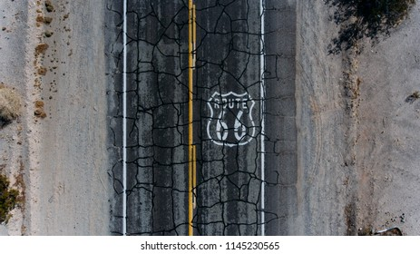 Top view of asphalt roadside crossing desert environment in USA, aerial scenery view of famous interstate landmark of Historic Route 66 located in wild lands