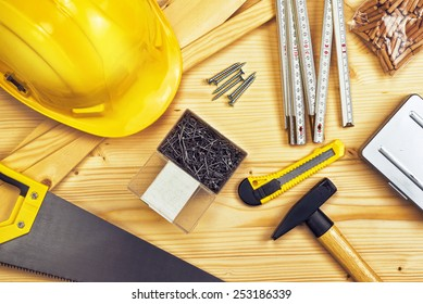 Top View of Assorted Woodwork and Carpentry or Construction Tools on Pine Wood Texture Background.