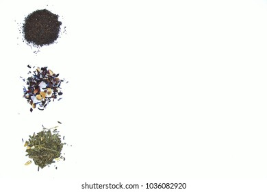 Top view of an assortment of loose tea leaves  isolated on white: black tea, karkade and green tea