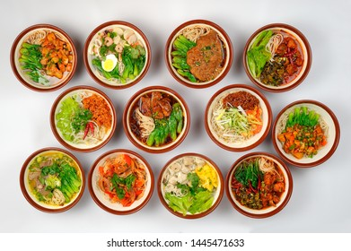 Top view at assortment of tasty and fresh samples Chinese noodles soups with meat and vegetables.