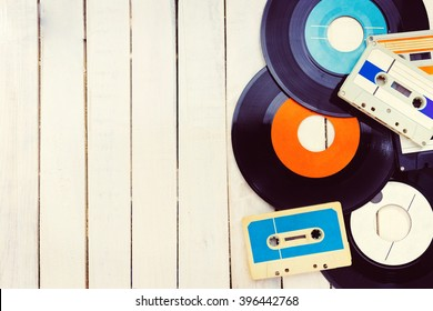 Top view of  audio cassettes and gramophone records with negative space.