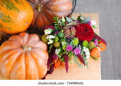 Top view of autumn composition of decorated pumpkins and autumn flowers