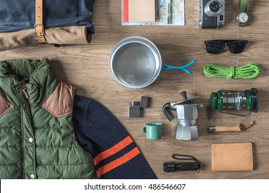 Top View of Autumn/Winter Travel Stuff on Wood Background