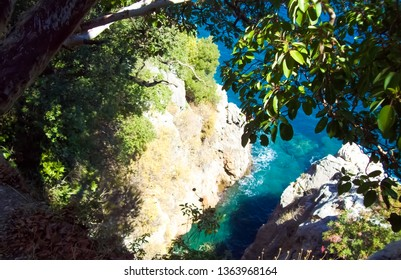 Top view of the azure sea and stones. Turkey.