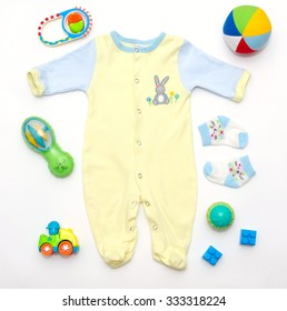 top view of baby boy yellow-blue clothes and toy stuff