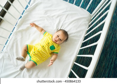 the top view of baby in cot, cradle