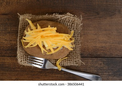 top view baked potato with cheese and butter