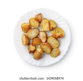 Top view of baked potatoes wedges on plate isolated on white