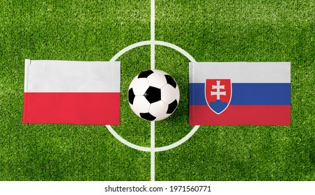 Top view ball with Poland vs. Slovakia flags match on green football field.