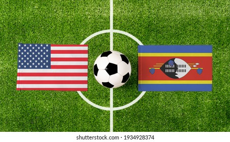 Top view ball with USA vs. Swaziland flags match on green soccer field.