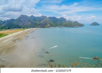 Top view of Ban Bang Pu Beach beautiful of long beach with blue-green sea with the hill and blue sky background, taken from climbing the hill to Phraya Nakhon Cave. Prachuap Khiri Khan, Thailand.