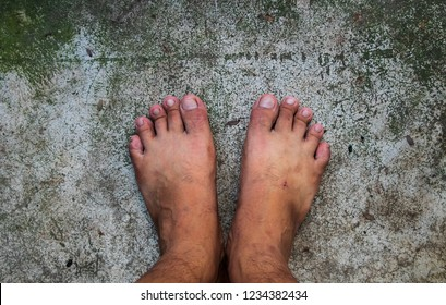 Top View of Bare Foot on Cement Floor Background. Walk to the Nature. Relax
