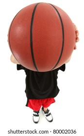Top view of basket ball playing boy child ready to throw ball.  Close up view ball covering child's face.