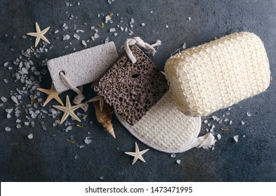 Top view of bath tools, sea salt, starfishes on the rustic grey surface.Pumice, eco sponges