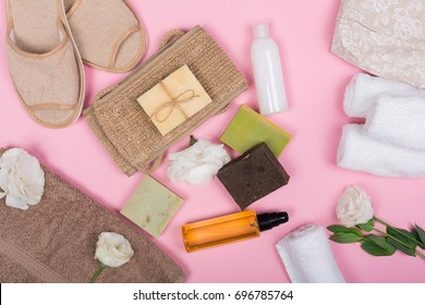 Top view bathroom supplies and spa cosmetics on pink background