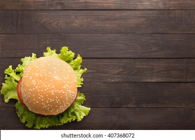 Top view bbq hamburger on the wooden background.