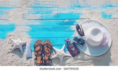 Top view of Beach Accessories On Blue Plank - Summer Holiday Banner. travel concept.