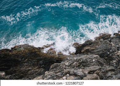 Top view of the beautiful blue ocean by the cliff and rocks