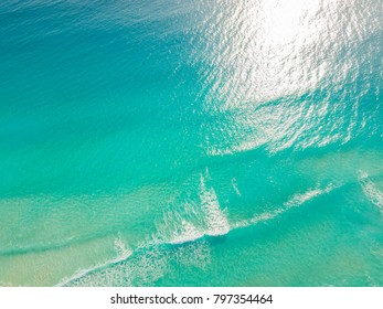 Top view of beautiful Caribbean Sea. Aerial drone shot of turquoise sea water - space for text. Aquamarine Sea background