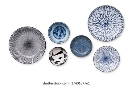 Top view of beautiful crockery set with porcelain ceramic plate round dish and cup bowl isolated on white background.