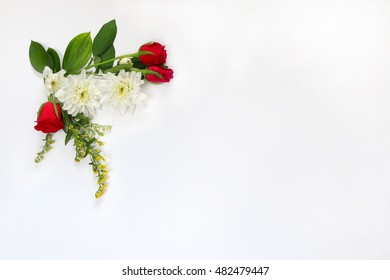 Top view of beautiful flowers arrangement on white isolated background. Copy space
