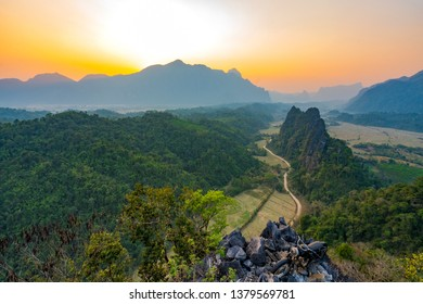 Top view of Beautiful Forest landscape of Sunset at pha Namxay Mountains Vang Vieng, Laos.