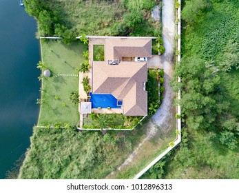 Top View Beautiful Garden Villa Resort, Above the Holiday Villa with swimming Pool on the lake with green garden. Aerial Drone Top View Top View Village scenic Landscape.