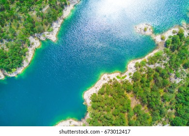 Top view of a beautiful mountain lake surrounded by green forest