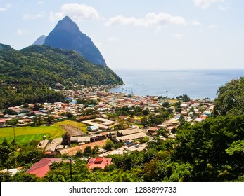top view of beautiful soufriere village and pitons at jalousie bay st. lucia