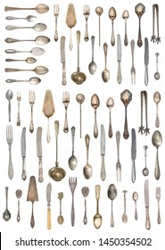 Top view of beautiful vintage silver knifes, spoons and forks  isolated on white background. Silverware.
