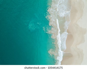 Top view of beautiful white sand beach and turquoise sea water, aerial drone shot. Amazing nature background.