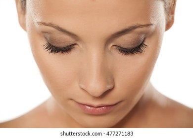 top view of a beautiful woman's face with natural lashes