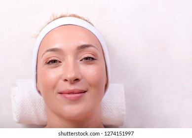 Top view of beautiful young woman with clean fresh skin, face skin treatment.