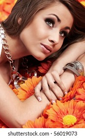 Top view of a beautiful young woman lying on a flowers