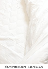 Top view of bedding sheets and blanket texture abstract background with sunlight in the morning.