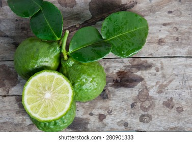 Top view Bergamot with green leafs on wood background