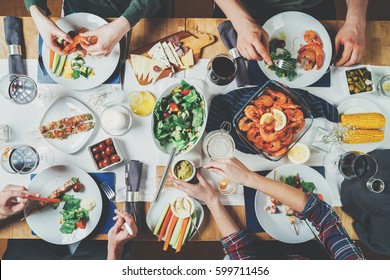 Top view of best friends dinning together, happy friends celebrating, holidays and traditions concept, Mediterranean Kitchen, festive table